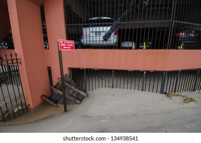 BROOKLYN, NY/USA - OCTOBER 30: Sand deposited in the aftermath of hurricane Sandy fills a parking garage on October 30, 2012 in the Brighton Beach/Coney Island section of Brooklyn.