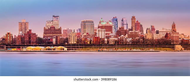Brooklyn skyline panorama under a sunset light.
