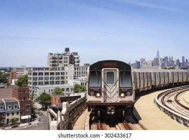 Brooklyn skyline with subway train