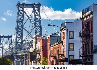 Brooklyn street scene with block of buildings near the Williamsburg Bridge in New York City
