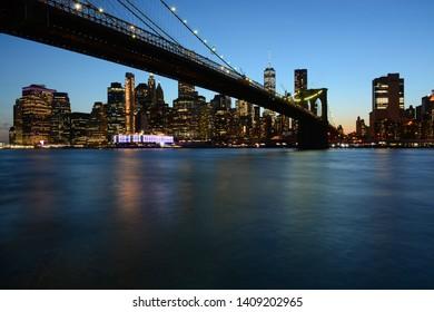Brooklyn, USA - May 27, 2019: Night view to Manhattan from Main Street Park near Brooklyn Bridge