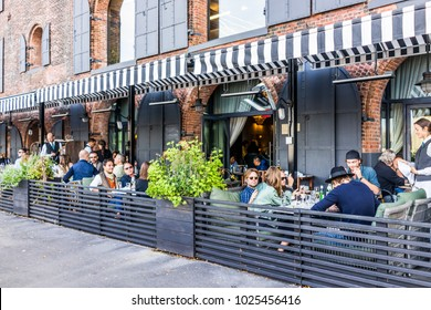 Brooklyn, USA - October 28, 2017: Dumbo outside exterior outdoors in NYC New York City, people sitting eating in Italian restaurant Cecconis