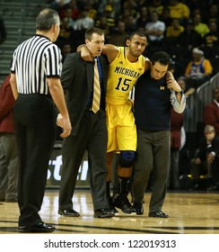 BROOKLYN-DEC 15: Michigan Wolverines forward Jon Horford (15) is escorted off the court after an injury against the West Virginia Mountaineers at Barclays Center on December 15, 2012 in Brooklyn.