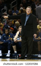 BROOKLYN-DEC 15: West Virginia Mountaineers head coach Bob Huggins reacts on the sidelines against the Michigan Wolverines during the second half at Barclays Center on December 15, 2012 in Brooklyn.