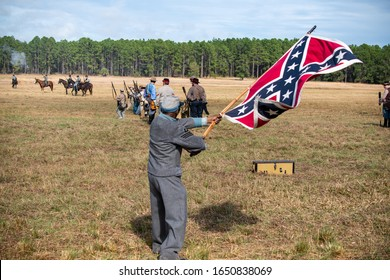 Brooksville, FL - January 19, 2020: An African-American Civil War Reenactor waves a large confederate flag at the reenactment of the Brooksville Raid, in Florida.