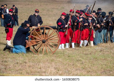 Brooksville, FL - January 19, 2020: Reenactors portraying Union troops at the time of the American Civil War prepare to fire a Gatling Gun.
