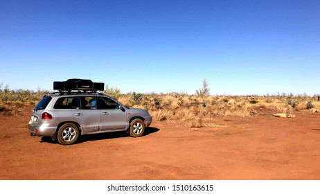 Broome, Australia - 07 20 2019: Hyundai Santa Fe with roof top tent parked on a free camping spot in the Pilbara / East Kimberley Region in Western Australia