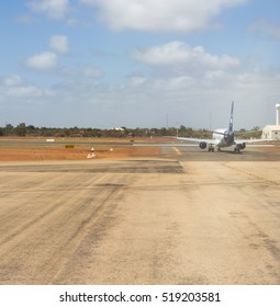 Broome International Airport runway , North Western Australia on a cloudy hot summer Wet Season afternoon  is always busy with planes arriving and departing  for Darwin and Perth and other places.