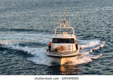 """Broome, Western Australia/ Australia - July 19 2017: Pilot boat """"Kestrel"""" comes out at sunrise to put the Pilot on board an arriving passenger ship. Fenders allow the boat to come alongside the ship"""