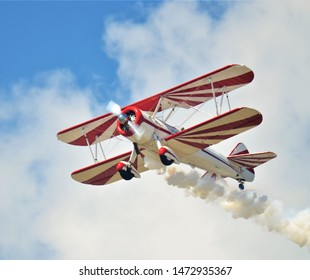 Broomfield, CO, USA. Aug 15, 2015. Old Biplane Aircraft performing for the crowd at the Broomfield Airshow. A biplane is a fixed-wing aircraft with two main wings stacked one above the other.