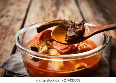 Broth from the bones and vegetables in the glass dish