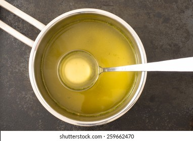 Broth in a steel pot on the stove