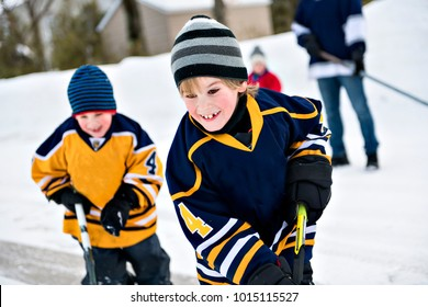 brother playing hockey in street