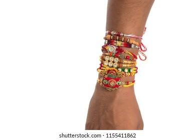 Brother showing rakhi on his hand on an occasion of Raksha Bandhan festival.