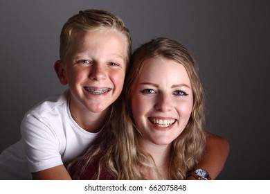 Brother and sister being happy