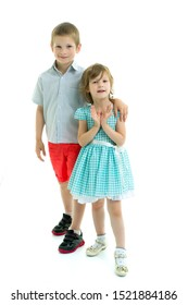 Brother and sister, boy and girl posing in the studio. Friendshi