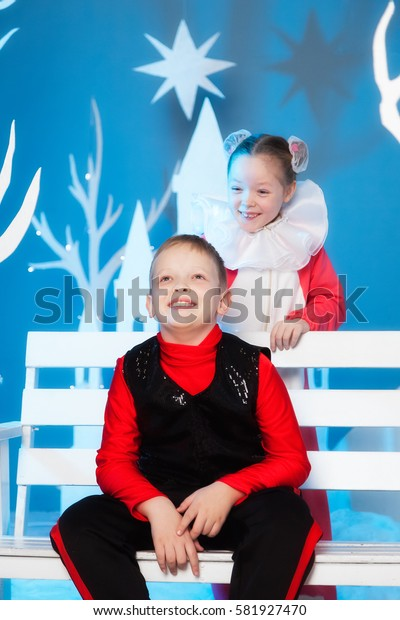 Brother and sister in carnival costumes