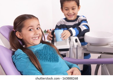 brother and sister in dental office