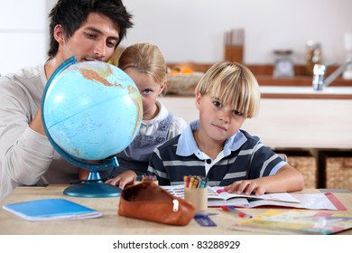 Brother and sister doing geography homework