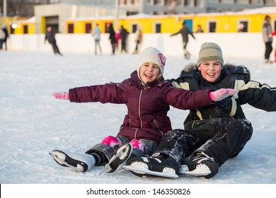 Brother and sister fell while skating and having fun on the ice