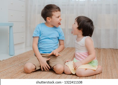 Brother and sister grimacing debate. A confrontation between siblings. Kids are bullies. Naughty jokers children's fun. Restless. Child psychology friendship. parenting. baby 3 years and 6 years