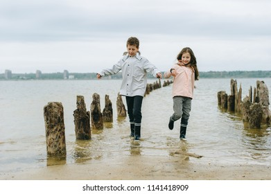 brother and sister have a fun and playing near the sea