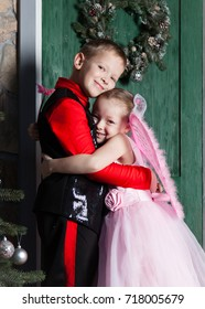 Brother and sister are hugging at the door of the house at Christmas