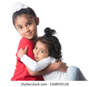 Brother and sister hugging. Siblings warm hug. Indian Thai Sikh brother sister loving embrace.