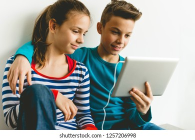 Brother and sister listening music