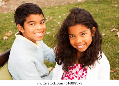 Brother and sister. Little girl with her big brother.