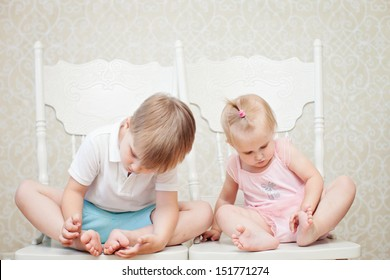 brother and sister looking at their feet
