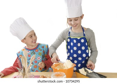 a brother and sister making fun in the kitchen and baking cake