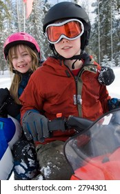 Brother and Sister on Snowmobile