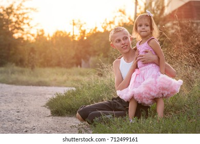 Brother and sister on a walk,  boy and girl are walking