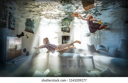 brother and sister play in flooded room