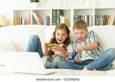 Brother and sister play videogames