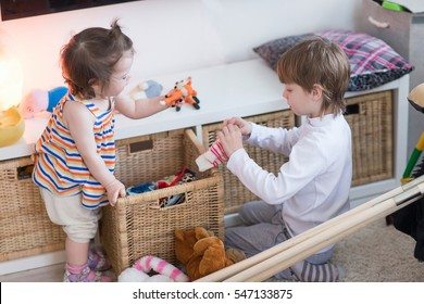 Brother and sister playing in the nursery
