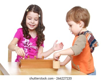 Brother and sister playing at the table.- isolated on white background