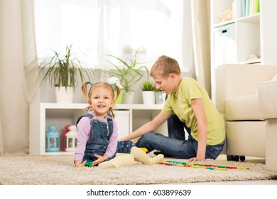 Brother and sister are playing together in the room