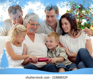 Brother and sister pulling crackers in Christmas against snow flake frame in blue