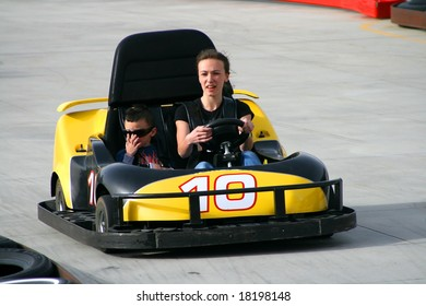 Brother and Sister racing on the Go Cart