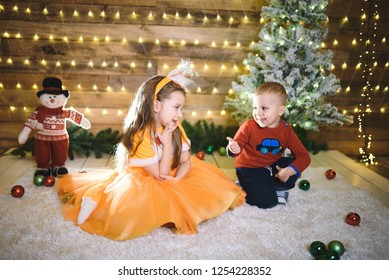 brother and sister talking at christmas studio