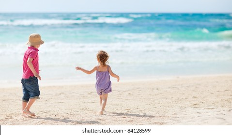 Brother and sister together on tropical beach
