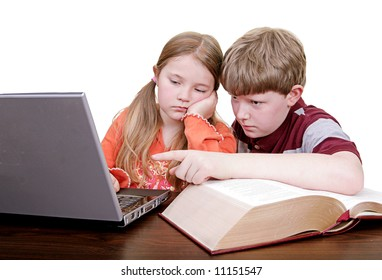 brother and sister using the laptop for homework