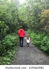 Brother and Sister walking in wooded trail