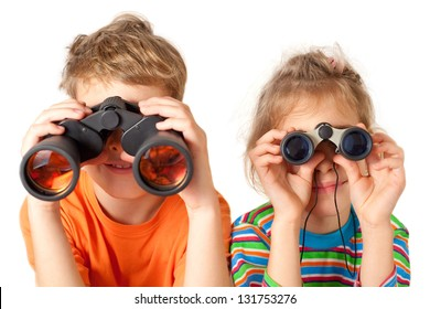 Brother and sister watching through binoculars on a white background
