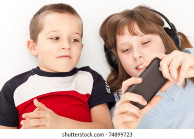 brother and sister watching  video on smart phone
