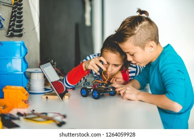Brother and sister working on school project