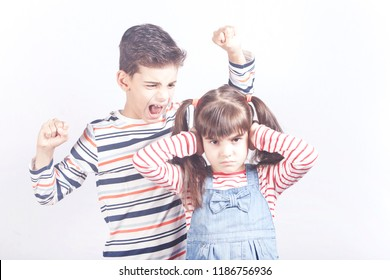 Brother yelling at his sister. Kids arguing concept