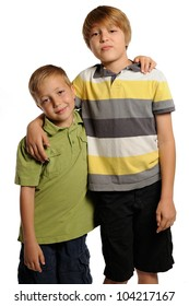 Brotherly Love. Seven and nine year old boys standing with their arms around each other.